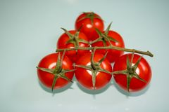 Bunch of fresh small tomatoes on the table royalty free stock photo