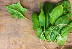 A bunch of fresh spinach on the table Royalty Free Stock Images