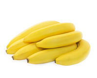 Bunch of fresh spotless yellow bananas. Isolated over white background Stock Photo