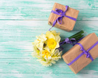 Bunch of fresh  spring  flowers and gift boxes Royalty Free Stock Image