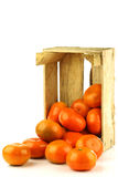 Bunch of fresh tangerines coming out of  a box Royalty Free Stock Photography
