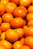 Bunch of fresh tangerines oranges on market. Stock Images