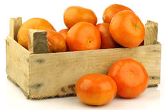 Bunch of fresh tangerines in a wooden box Stock Images