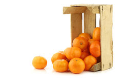 Bunch of fresh tangerines in a wooden box Stock Photos