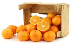 Bunch of fresh tangerines in a wooden box Royalty Free Stock Image