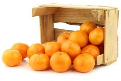 Bunch of fresh tangerines in a wooden box Royalty Free Stock Photography