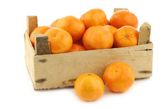 Bunch of fresh tangerines in a wooden box Royalty Free Stock Images