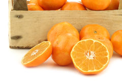 Bunch of fresh tangerines in a wooden box Stock Image