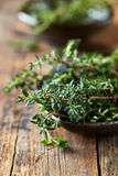 Bunch of fresh thyme in a ceramic dish Royalty Free Stock Photos