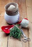 Bunch of fresh thyme with gardening and cooking utensils Stock Images
