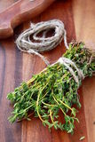 Bunch of fresh thyme and a knife Stock Image