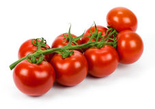 Bunch of fresh tomatoes. Isolated on white background. Royalty Free Stock Photography