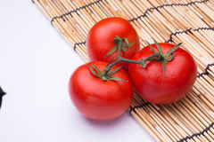 Bunch of fresh tomatoes with water drops. Stock Photography