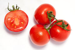 Bunch of fresh tomatoes with water drops Stock Photo