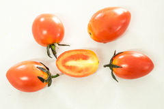 Bunch of fresh tomatoes with water drops on white background Stock Photo