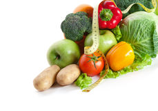 Bunch of fresh vegetables with measuring tape Stock Photos