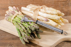Bunch of fresh white and green asparagus. On a cutting board Stock Photo