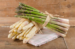 Bunch of fresh white and green asparagus. On a towel Royalty Free Stock Photo