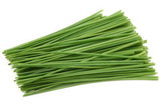 Bunch of freshly cut green chive. On white background royalty free stock photo
