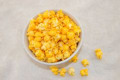 A bunch of freshly popped popcorn. A piece of freshly popped popcorn with cheese on a white background Royalty Free Stock Images