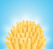 Bunch of fries. On smooth blue background. Clipping path of fries is included Royalty Free Stock Image
