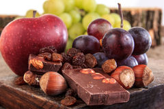 Bunch of fruit apples and grapes with nuts chocolate Stock Photo
