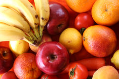 Bunch of fruits. Oranges, tomato, lemone, apples & banana royalty free stock photos