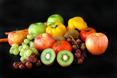 Bunch of fruits on black background. Bunch of fresh fruits on jute stock photography
