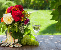 Bunch of garden flowers and grape Stock Photo