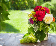 Bunch of garden flowers and grape Royalty Free Stock Photo