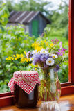 Bunch of garden flowers and jam Stock Photos