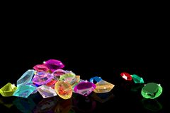 A bunch of gems on a mirrored background. Royalty Free Stock Photography