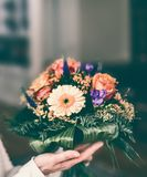 Bunch with Gerbera and roses in female hand Royalty Free Stock Photos