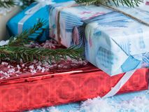 Bunch of gift boxes on a blue background of trees Royalty Free Stock Photo