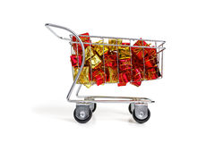 Bunch of gifts in a shopping cart - side view Royalty Free Stock Images