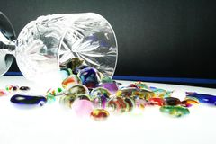 A bunch of glass beads spilled out. Colorful hand made beads spilled out on the table Royalty Free Stock Photos