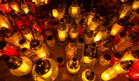 Bunch of glass candles in the cemetery Royalty Free Stock Image