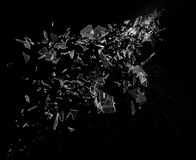 Glass shards flying. A bunch of glass shards and fragments flying across the air stock photos