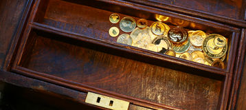 Bunch of gold coins in a wooden casket Royalty Free Stock Images