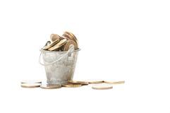 Bunch of golden coins in a small bucket Stock Photos