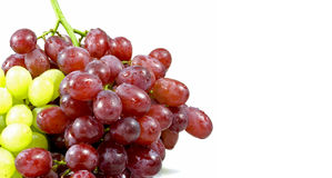 Bunch of grapes. Bunch of red and green grapes in front of a white background Stock Photo