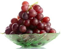 Bunch of grapes. Bunch of red grapes on a glass plate Stock Photography
