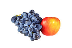Bunch of grapes and an apple Royalty Free Stock Images