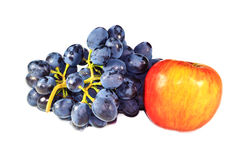 Bunch of grapes and an apple Stock Photography