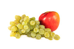 Bunch of grapes and an apple Royalty Free Stock Photos