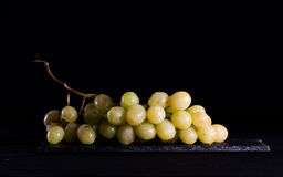 Bunch of grapes. With black background Royalty Free Stock Image