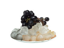 Bunch of grapes. Bunch of black grape on ice cubes Stock Photo