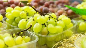Bunch of grapes on counter stock photography