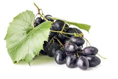 Bunch of grapes with leaves isolated on white background Stock Photo