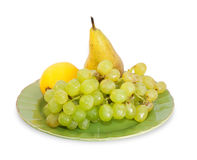 Bunch of grapes, lemon and pear Royalty Free Stock Photography